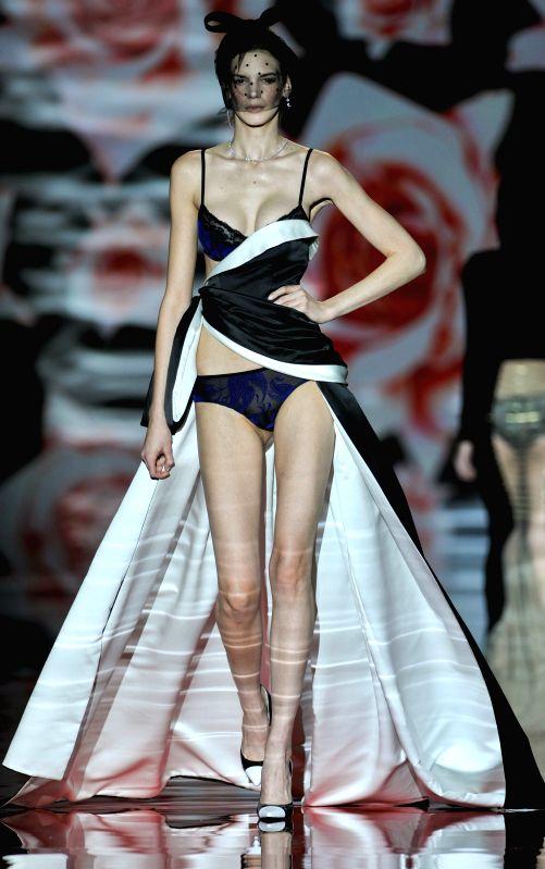 A model presents a creation by Spanish designer Nuria Sarda during the Madrid Fashion Week in Madrid, Spain, Feb. 7, 2015.