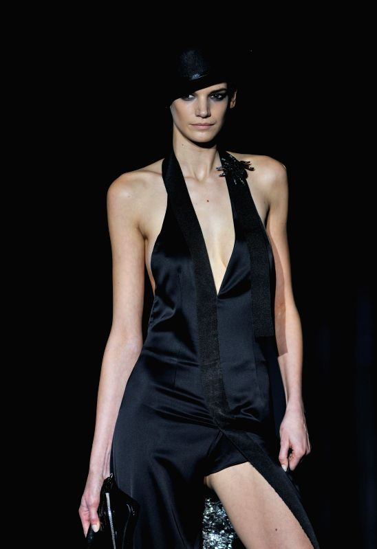 A model presents a creation by Spanish designer Roberto Verino during the Madrid Fashion Week in Madrid, Spain, Feb. 7, 2015.