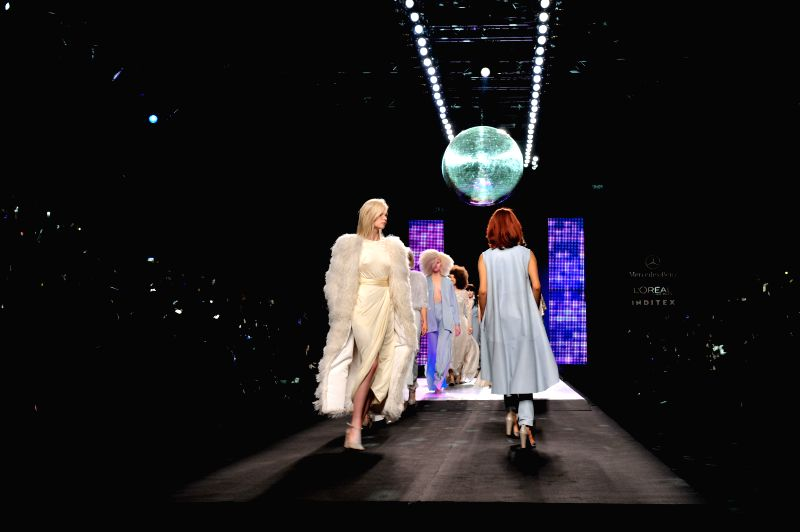 Models present creations by Spanish designer Juan Duyos during the Madrid Fashion Week in Madrid, Spain, Feb. 7, 2015.