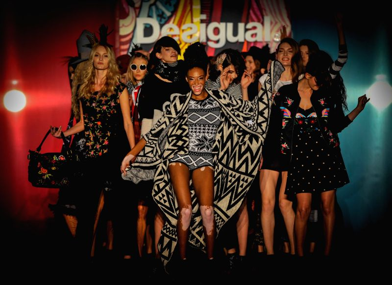 Models present the Autumn/Winter 2015 design by Desigual during the Madrid Fashion Week in Madrid, Spain, Feb. 6, 2015.