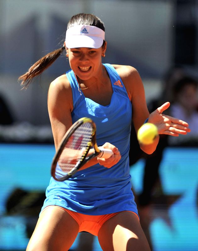 MADRID, French tennis player Mula Jie Norwich in action against her Russian counterpart Maria Kirilenko during the first round match of the WTA Madrid Open women's singles in Madrid, Spain on May 4, .