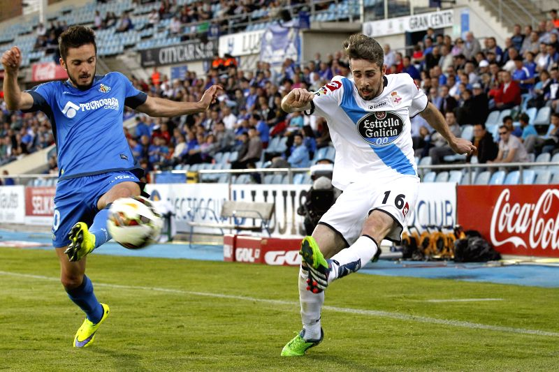 "Getafe's midfielder Pablo Sarabia (L) duels for the ball with Deportivo Coruna's Portuguese defender Luis Carlos ""Luisinho"" (R) during the Spanish Liga Primera Division soccer match ..."