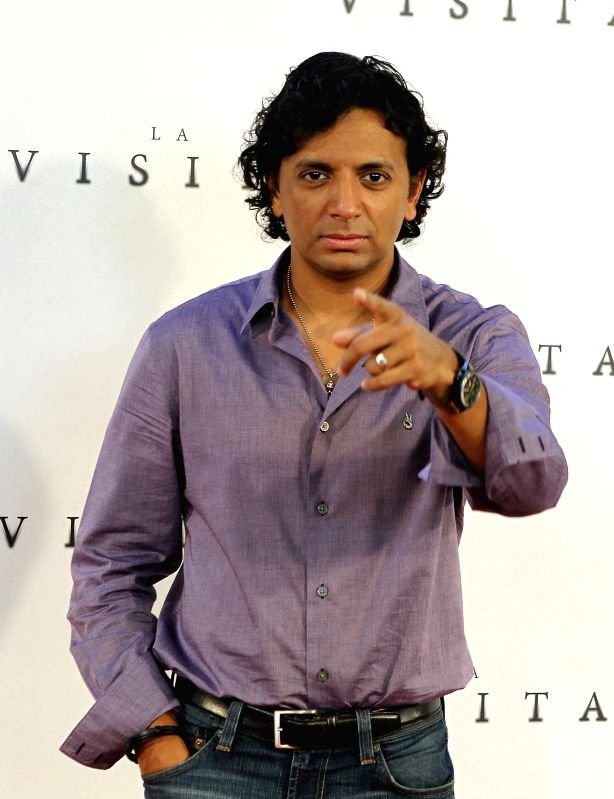 """Madrid: Indian film director Night Shyamalan during a photocall to present his latest film, """"The Visit"""", 02 September 2015 in Madrid, Spain. (IANS/EFE/JUAN M.ESPINOSA)"""