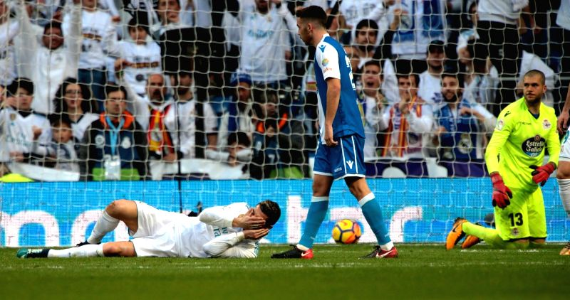 MADRID, Jan. 22, 2018 - Real Madrid's Cristiano Ronaldo (Bottom) gets injured during a Spanish league match between Real Madrid and Deportivo de la Coruna in Madrid, Spain, on Jan. 21, 2018. Real ...