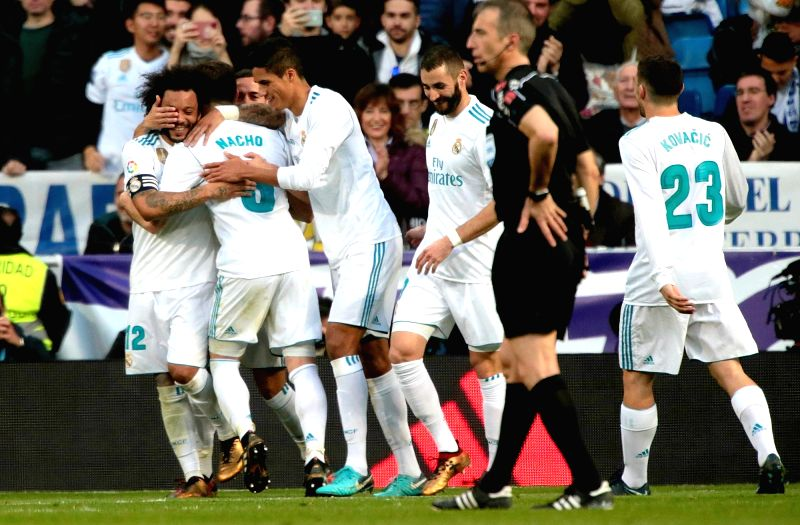 MADRID, Jan. 22, 2018 - Real Madrid's players celebrate after a Spanish league match between Real Madrid and Deportivo de la Coruna in Madrid, Spain, on Jan. 21, 2018. Real Madrid won 7-1.
