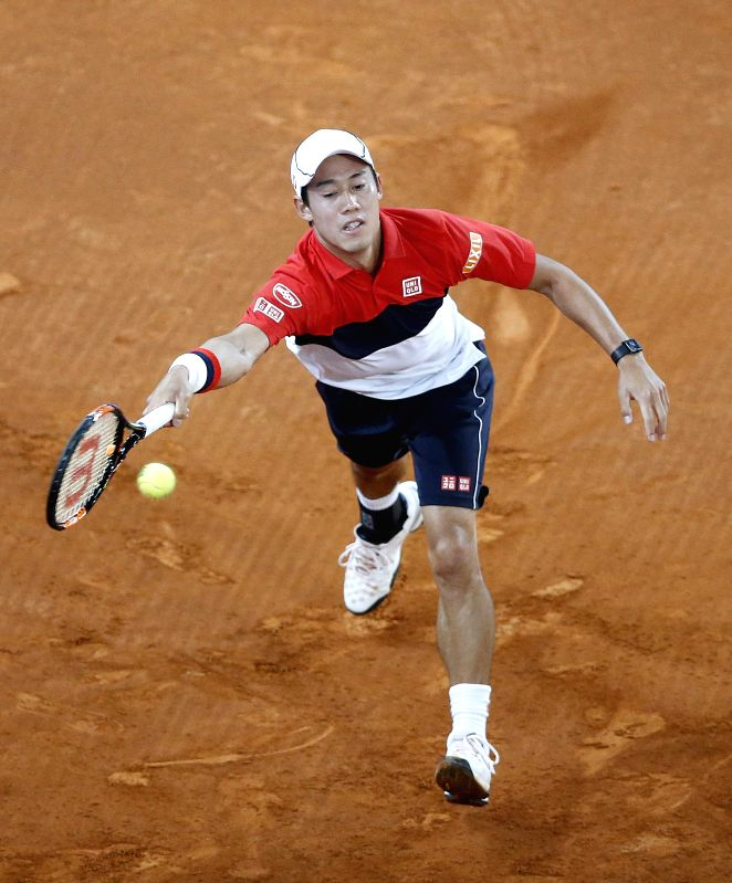 Japanese Kei Nishikori in action against Spanish David Ferrer during their quarterfinal match for the Madrid Open tennis tournament at Caja Magica pavilion, in Madrid, Spain, 08 May 2015. ...