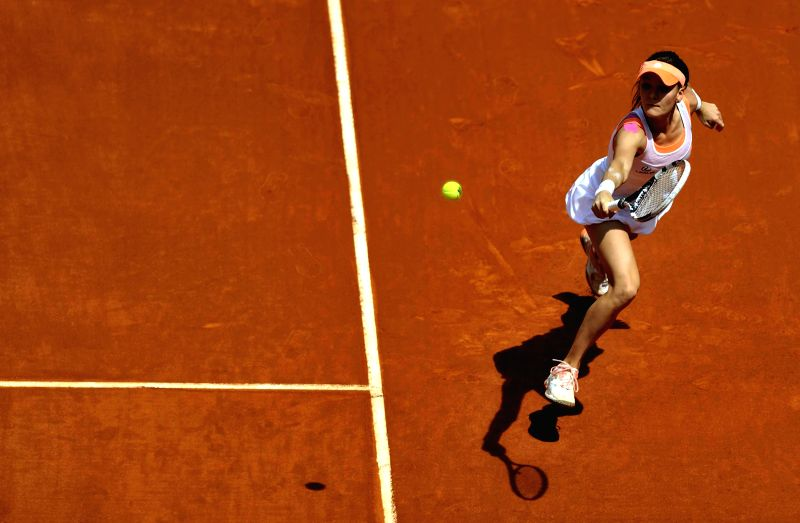 Agnieszka Radwanska of Poland returns a shot during the women's singles semifinal against Maria Sharapova of Russia at the Madrid Open tennis tournament in Madrid, ...