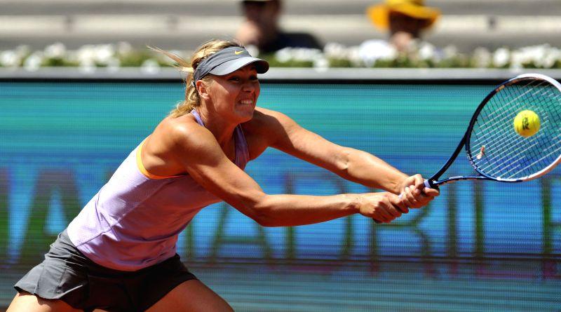 Maria Sharapova of Russia returns a shot during the women's singles semifinal against Agnieszka Radwanska of Poland at the Madrid Open tennis tournament in Madrid, ...