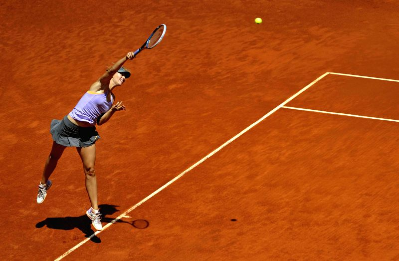 Maria Sharapova of Russia serves to Agnieszka Radwanska of Poland during the women's singles semifinal at the Madrid Open tennis tournament in Madrid, capital of ...