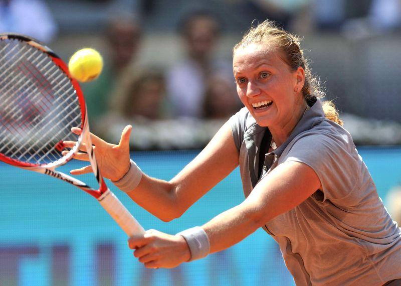 The Czech Republic's Petra Kvitova returns a shot to Simona Halep of Romania during the women's singles semifinal at the Madrid Open tennis tournament in Madrid, ...