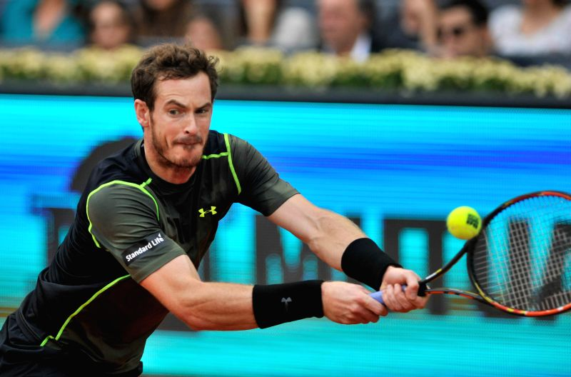 Britain's Andy Murray returns the ball during the final match against Spain's Rafael Nadal at the Madrid Open tennis tournament in Madrid, Spain, May 10, 2015. Murray ...