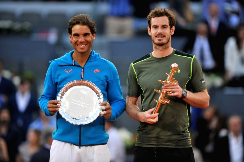 Britain's Andy Murray (R) and Spain's Rafael Nadal pose with their trophies after the final match at the Madrid Open tennis tournament in Madrid, Spain, May 10, 2015. ...