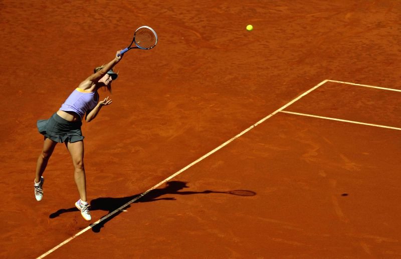 Maria Sharapova of Russia serves to Simona Halep of Romania during the women's singles final match at the 2014 Madrid Tennis Open in Madrid, Spain, May 11, 2014. ...