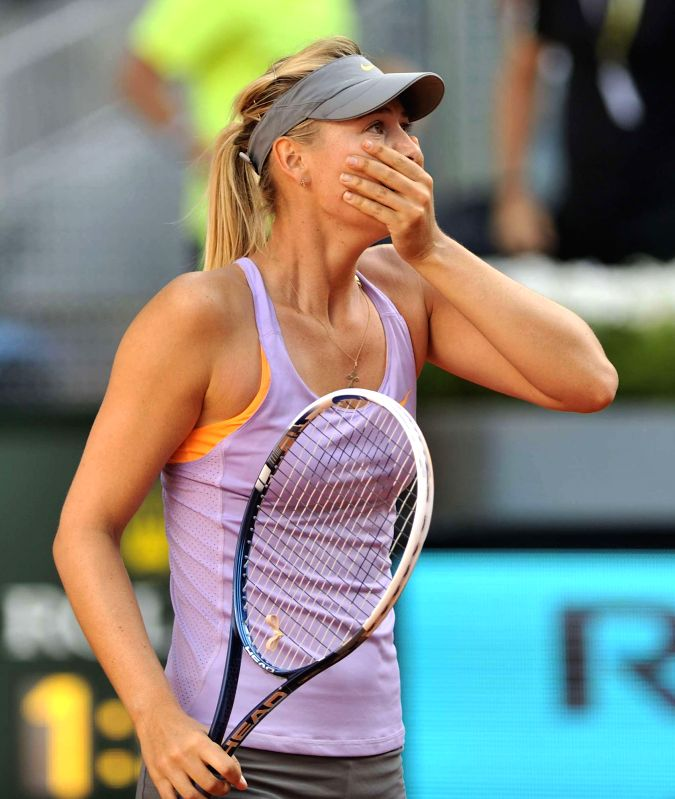 Maria Sharapova of Russia reacts after the women's singles final match against Simona Halep of Romania at the 2014 Madrid Tennis Open in Madrid, Spain, May 11, 2014. .