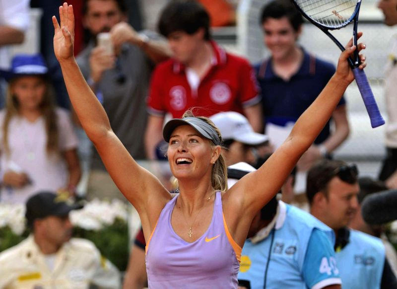 Maria Sharapova of Russia celebrates for victory after the women's singles final match against Simona Halep of Romania at the 2014 Madrid Tennis Open in Madrid, ...