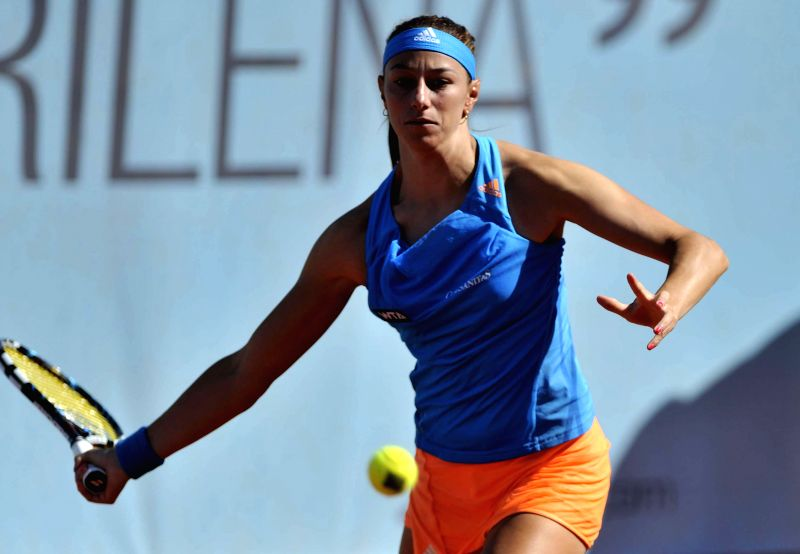 Russian tennis player Maria Kirilenko in action against her French counterpart Mula Jie Norwich during the first round match of the WTA Madrid Open women's singles in .