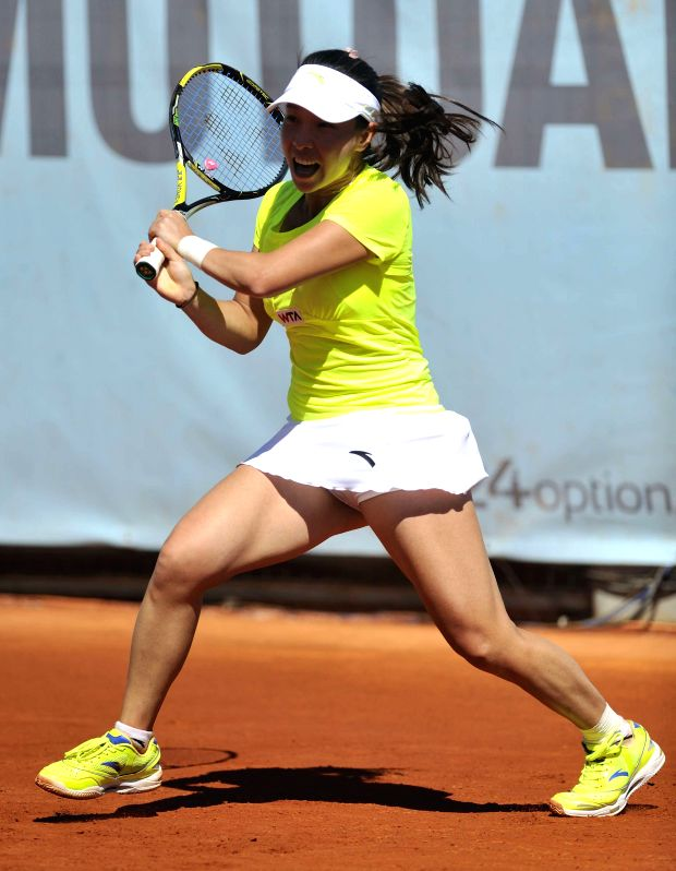 Zheng Jie of China returns the ball during the women's singles first round match against Mariana Duque-Marino of Colombia at the WTA Mutua Madrid Open in Madrid, ...