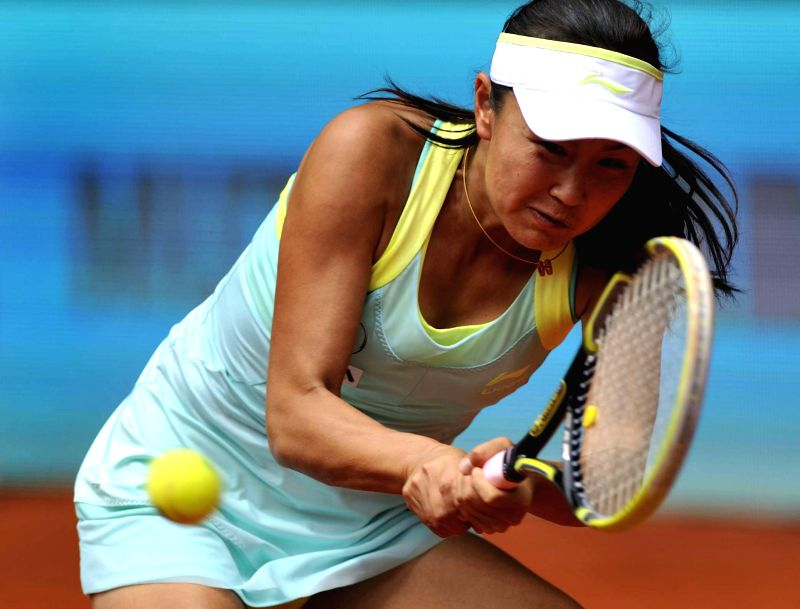 China's Peng Shuai returns a shot to Serena Williams of the United States during women's singles second round at the Madrid Open tennis tournament in Madrid, capital ..