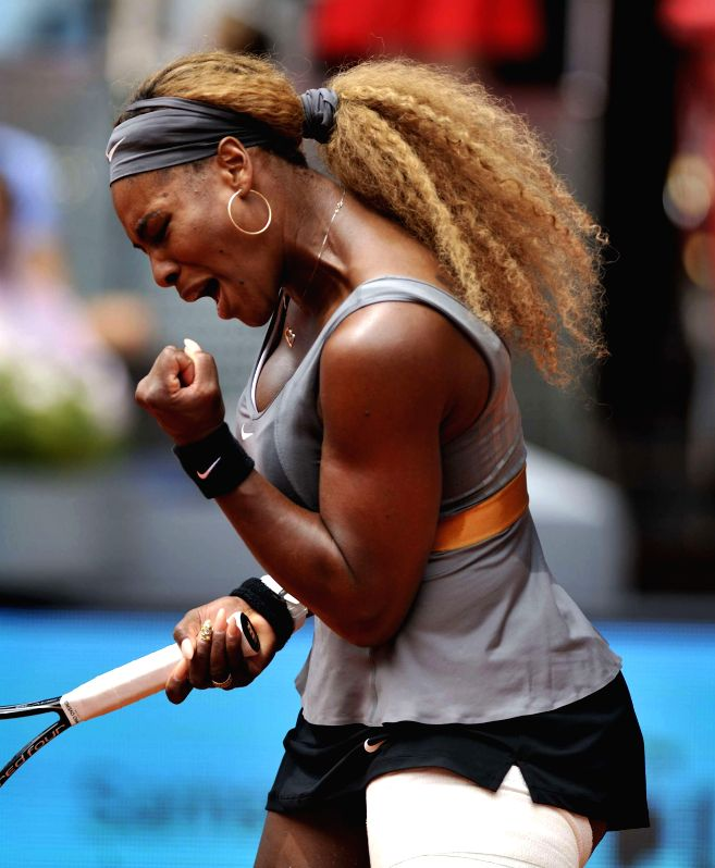 Serena Williams of the United States jubilates during women's singles second round against China's Peng Shuai at the Madrid Open tennis tournament in Madrid, capital ..