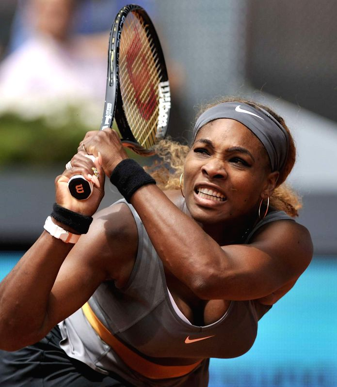 Serena Williams of the United States returns a shot to China's Peng Shuai during women's singles second round at the Madrid Open tennis tournament in Madrid, capital ..