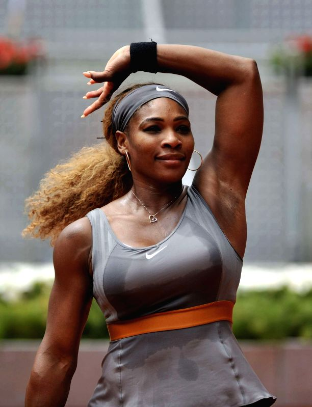 Serena Williams of the United States celebrates victory after women's singles second round against China's Peng Shuai at the Madrid Open tennis tournament in Madrid, ..