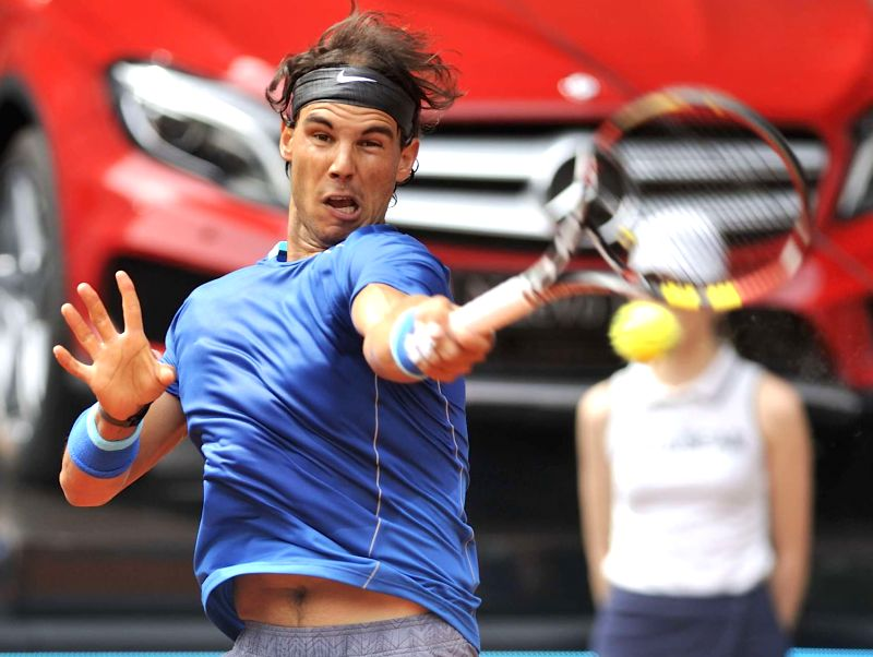 Spain's Rafael Nadal returns the ball to Argentina's Juan Monaco during the men's singles second round at the Madrid Open tennis tournament in Madrid, capital of ...