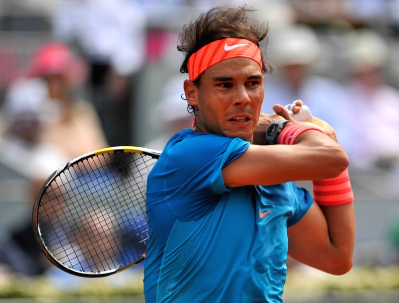 Rafael Nadal of Spain returns the ball during the men's singles quarterfinal against Grigor Dimitrov of Bulgaria at the Madrid Open tennis tournament in Madrid, Spain, ...