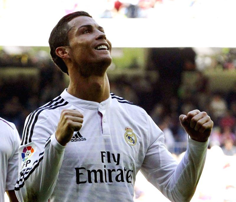 Real Madrid's forward Portuguese Cristiano Ronaldo celebrates his fifth goal against Granada during their primera division liga match held at the Santiago Bernabeu stadium in Madrid, Spain, ...