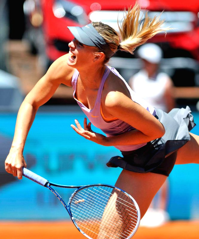 MADRID, Russian tennis player Maria Kirilenko in action against her French counterpart Mula Jie Norwich during the first round match of the WTA Madrid Open women's singles in Madrid, Spain on May 4, .
