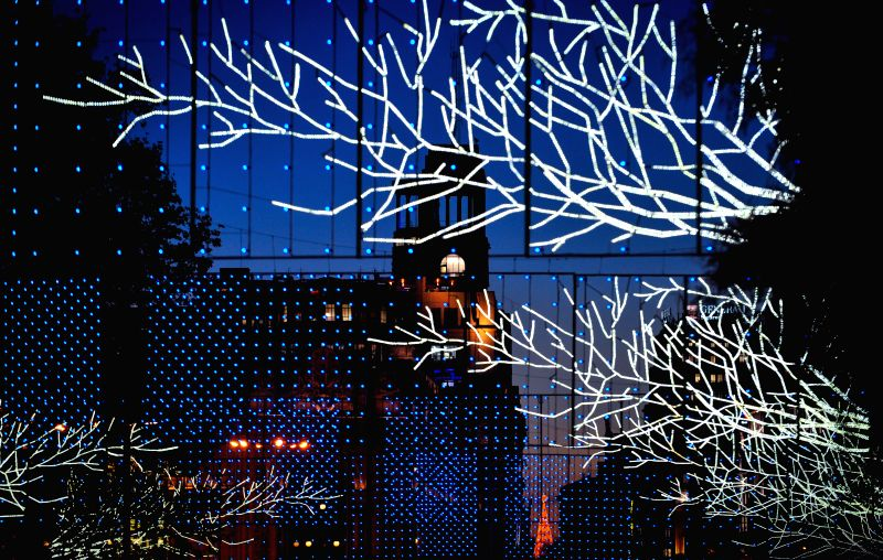Madrid (Spain): A street is illuminated with lights for Christmas in Madrid, Spain on Dec. 11, 2014. It is estimated that Madrid would invest 1.7 millions euros in Christmas illuminations in its ...