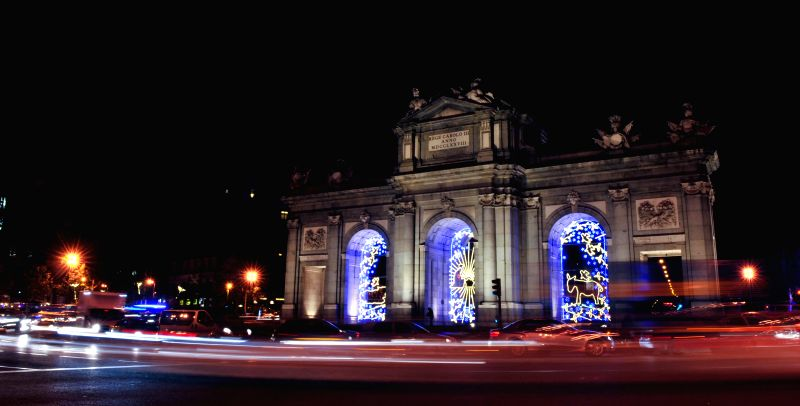 Madrid (Spain): Famous landmark Alcala Gate is illuminated with lights for Christmas in Madrid, Spain on Dec. 11, 2014. It is estimated that Madrid would invest 1.7 millions euros in Christmas ...
