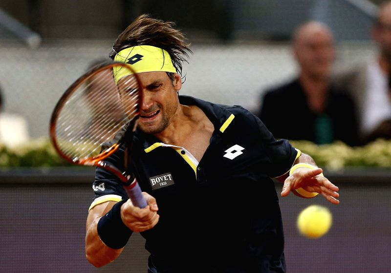 Spanish tennis player David Ferrer in action against Japanese Kei Nishikori during their quarterfinal match for the Madrid Open tennis tournament at Caja Magica pavilion, in Madrid, Spain, 08 ...
