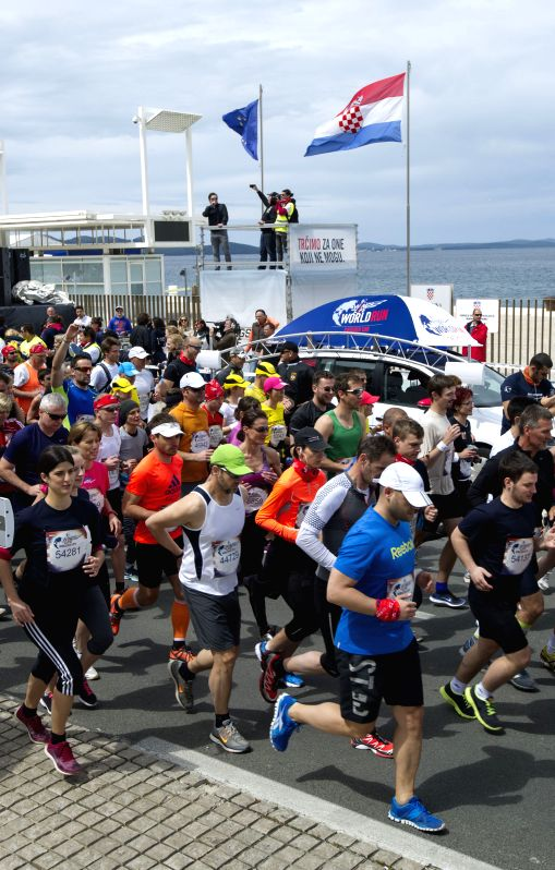 MADRID, ZADAR, May 4, 2014  - Runners compete during the Wings for Life World Run race in Zadar, Croatia, May 4, 2014. Almost 2500 participants took part in the global event held in Croatia's