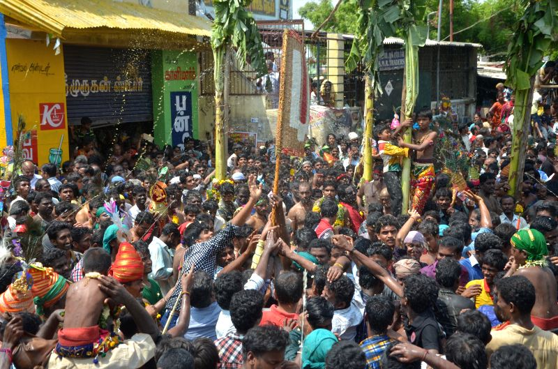 Devotees celebrate Chithirai Festival on the banks of Vaigai river in Madurai on the last day of Chithirai Festival, on May 4, 2015.