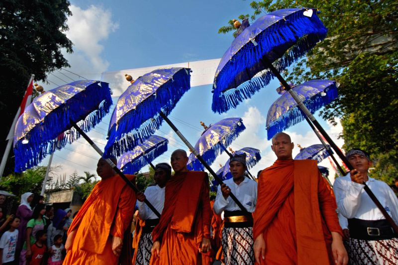 Buddhist monks join the procession from Mendut temple to Borobudur temple during celebrations for Vesak Day in Magelang, Central Java, Indonesia, on May 14, 2014. ..