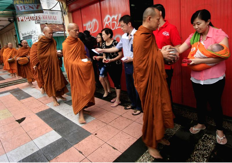 MAGELANG, May 21, 2016 - Buddhist monks collect alms from Buddhist followers ahead of Vesak Day in Magelang, Indonesia, May 21, 2016. Vesak Day, also known as the Buddha Day, will be celebrated on ...