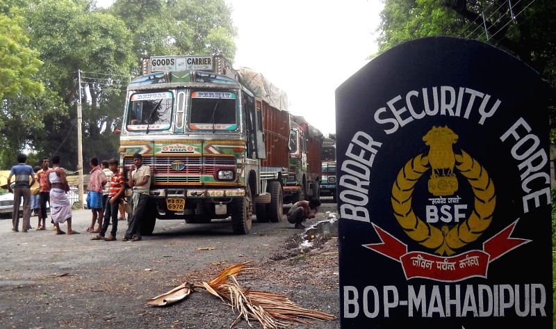 Trucks remain stranded at a BSF Border Outpost in Mahadipur of West Bengal due to ongoing political turmoil in Bangladesh on Jan 10, 2015.