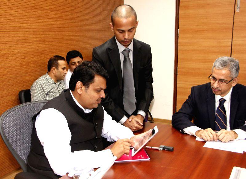 Maharashtra Chief Minister Devendra Fadnavis launches an application to curb corruption at Mantralaya in Mumbai, on Feb 25, 2015. - Devendra Fadnavis