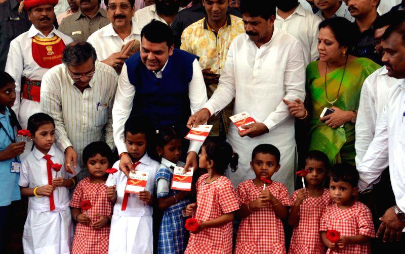 Maharashtra Chief Minister Devendra Fadnavis celebrates his birthday with children in Mumbai on July 22, 2016. - Devendra Fadnavis