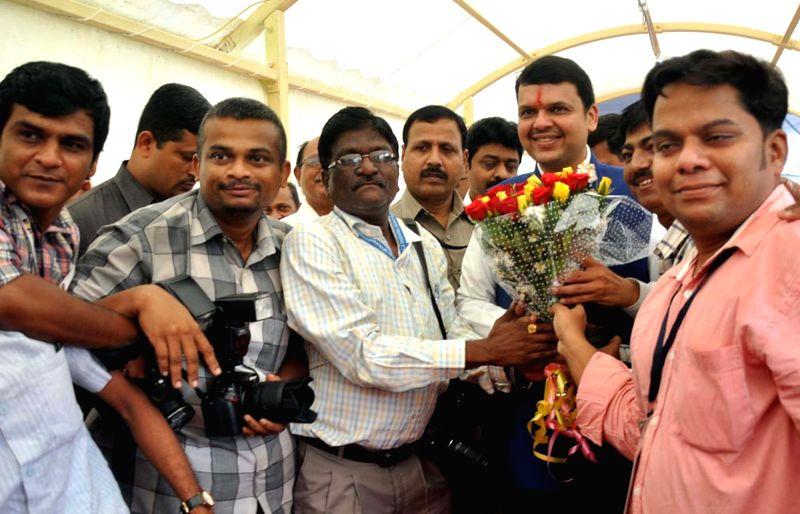 Maharashtra Chief Minister Devendra Fadnavis celebrates his birthday with photojournalists in Mumbai on July 22, 2016. - Devendra Fadnavis