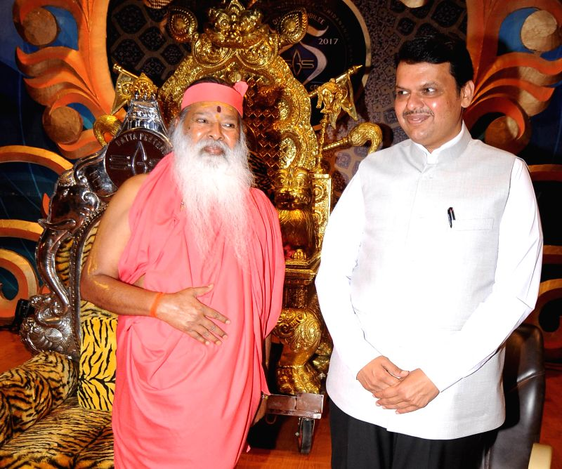 Maharashtra Chief Minister Devendra Fadnavis greets Ganapathi Sachchidananda on his 75th birthday celebrations at Datta Peetham in Mysuru, on May 25, 2017. - Devendra Fadnavis