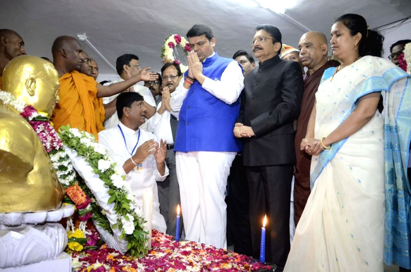 Maharashtra Chief Minister Devendra Fadnavis and Governor Chennamaneni Vidyasagar Rao pay homage to Babasaheb Dr. BR Ambedkar on his 60th Mahaparinirvan Diwas in Mumbai on Dec 6, 2015. - Devendra Fadnavis and Chennamaneni Vidyasagar Rao