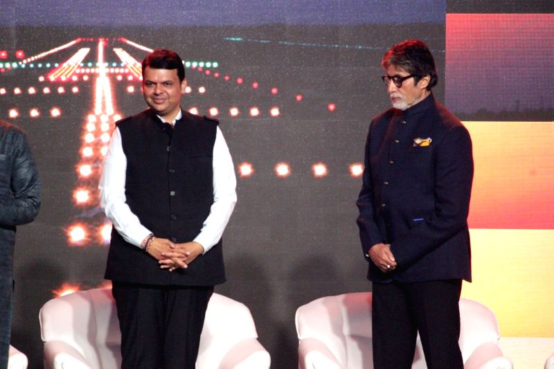 Maharashtra Chief Minister Devendra Fadnavis and actor Amitabh Bachchan during the launch of Nationalist Congress Party (NCP) leader Praful Patel's pictorial biography Udaan in Mumbai on May ... - Devendra Fadnavis, Amitabh Bachchan and Praful Patel