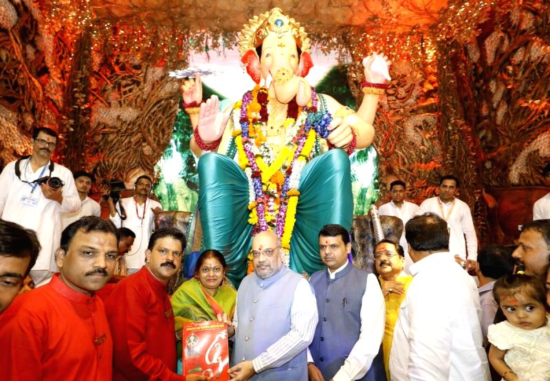 Maharashtra Chief Minister Devendra Fadnavis and BJP chief Amit Shah visits Lalbaugcha Raja Ganesh pandal in Mumbai on Sept 14, 2018. - Devendra Fadnavis and Amit Shah