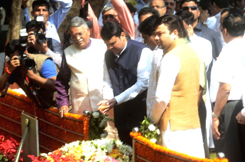 Maharashtra Chief Minister Devendra Fadnavis pays tribute to Shiv Sena founder Balasaheb Thackeray on his death anniversary at Balasaheb Thackeray memorial in Shivaji Park of Mumbai, on Nov. ... - Devendra Fadnavis