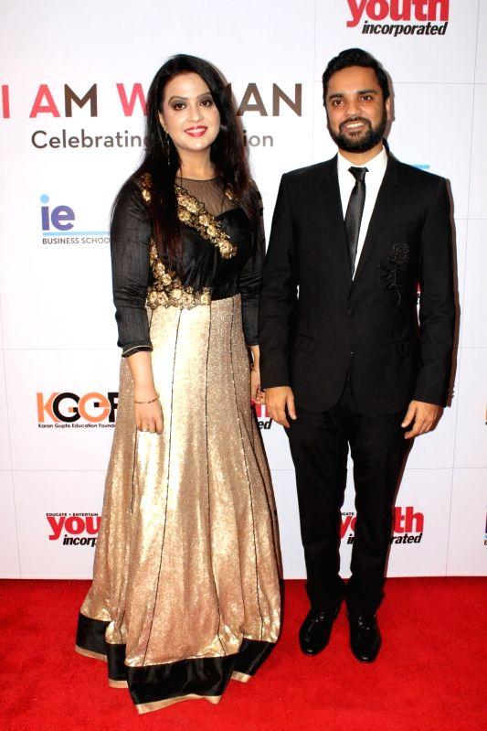"Maharashtra Chief Minister Devendra Fadnavis's wife Amruta Fadnavis during the ""I Am Woman Awards 2017"",  in Mumbai on April 27, 2017. - Devendra Fadnavi"