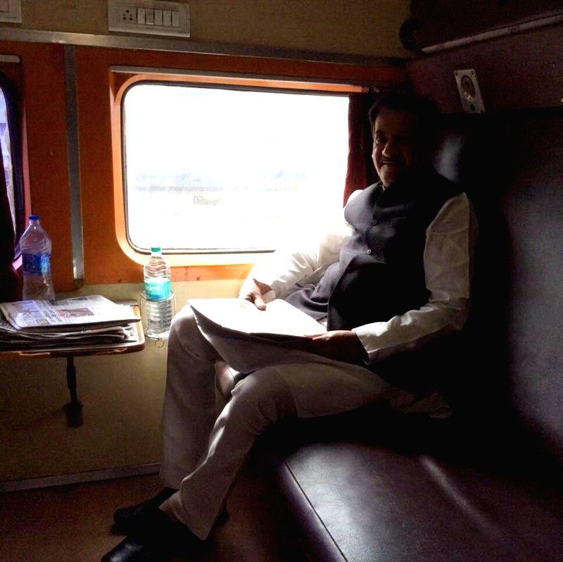 Maharashtra Chief Minister Prithviraj Chavan travels to Palghar aboard Bandra Vapi Passenger train on August 1, 2014.