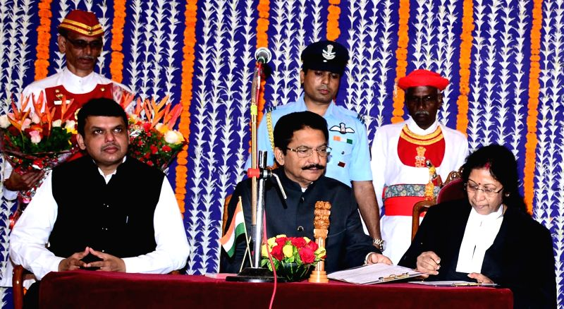 Maharashtra Governor C Vidyasagar Rao administers the oath of office to Chief Justice of the Calcutta High Court Justice Dr Manjula Chellur as the Chief Justice of the Bombay High Court ... - Devendra Fadnavis and C Vidyasagar Rao