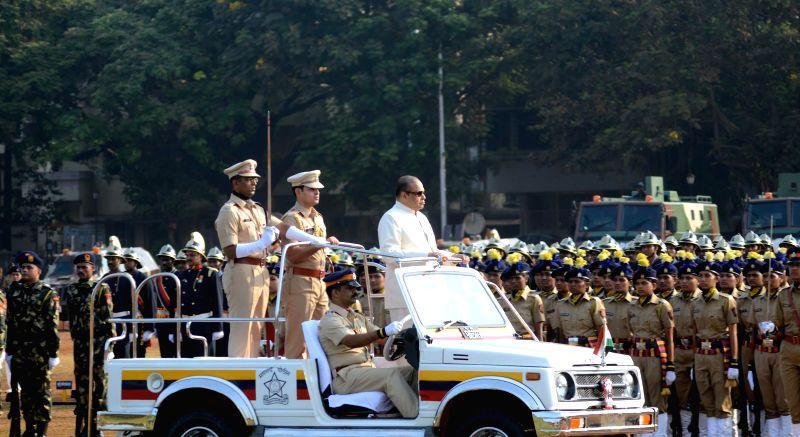 Maharashtra Governor K Sankaranarayanan inspects guard of honour during Maharshtra Day celebrations at Shivaji Park in Mumbai on May 1, 2014.