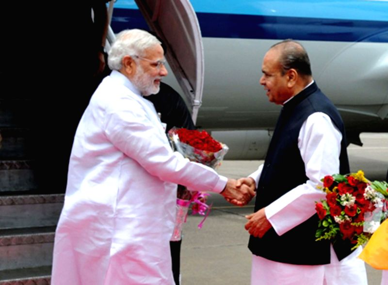 Maharashtra Governor K Sankaranarayanan receives Prime Minister Narendra Modi at Mumbai's CSIA Airport on July 21, 2014. - Narendra Modi